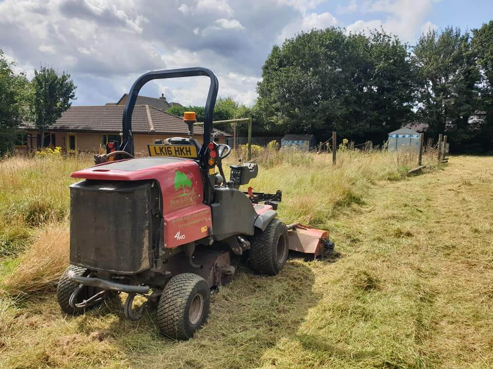 Mower tidying up playground