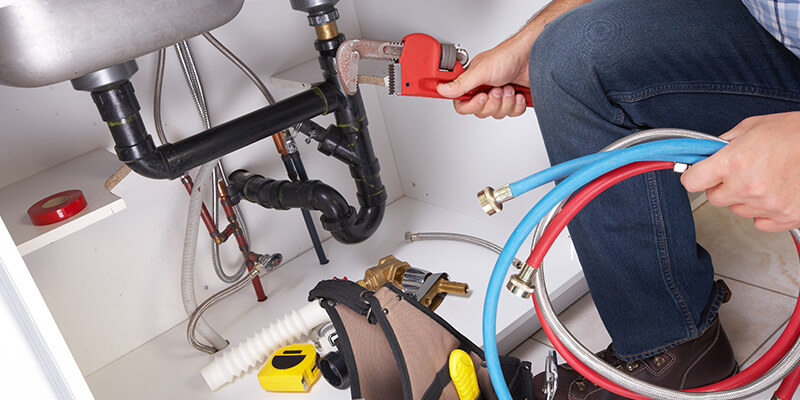 Plumber Checking Pipes